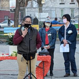 Photo of Nancy Nguyen giving a speech in a park.